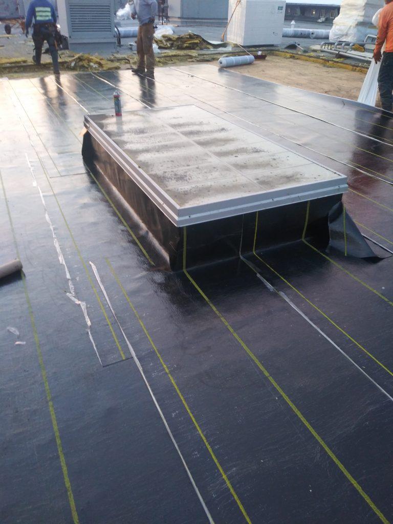 Capital High School Roof repair work by Olympic Roofing, LLC